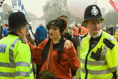 Police and party goer Stock Photography
