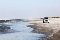Police patrol at Ameland Island, Netherlands Royalty Free Stock Photography
