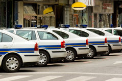 Police patrol automobiles on streets Stock Images