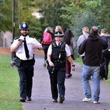 Police Patrol. BATH, UK - OCTOBER 20, 2015: Police patrol a street in the Royal Crescent's Victoria Park area. Despite calls for greater police protection Stock Photo