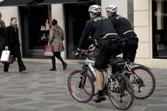 POLICE PATROL ON BIKES STROEGET PEDESTRAIN STREET Royalty Free Stock Images