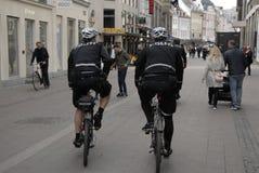 POLICE PATROL ON BIKES STROEGET PEDESTRAIN STREET Stock Image