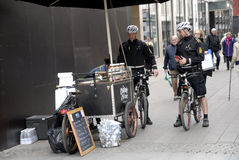 POLICE PATROL ON BIKES STROEGET PEDESTRAIN STREET Stock Photography