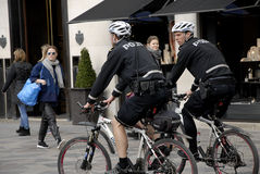 POLICE PATROL ON BIKES STROEGET PEDESTRAIN STREET Royalty Free Stock Photo