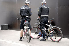 POLICE PATROL ON BIKES STROEGET PEDESTRAIN STREET Stock Photo