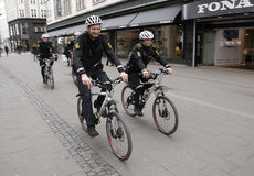 POLICE PATROL ON BIKES STROEGET PEDESTRAIN STREET Stock Photos