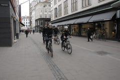 POLICE PATROL ON BIKES STROEGET PEDESTRAIN STREET Stock Images