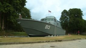 Police Patrol Boat on Land. Steady, medium wide shot of a landed police patrol boat exhibit stock video footage