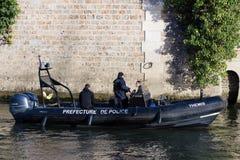 Police patrol boat on Seine river. Royalty Free Stock Photo