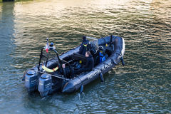 The police patrol boat on the Seine river. Royalty Free Stock Images