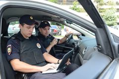 Police in the patrol car. Stock Images