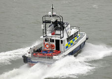 Police patrol catamaran at speed Stock Images