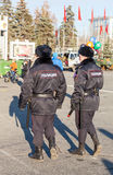 Police patrol at the central square in  sunny day Royalty Free Stock Photo