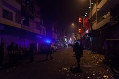Police patrol in the dirty slums. Royalty Free Stock Image