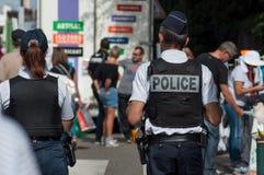 Police patrol in the pedestrian street during a flea market. Brunstatt - France - 16 September 2018 - police patrol in the pedestrian street during a flea market stock photography