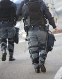 Police patrol in riot police with gun and pistol during revolt Stock Photo