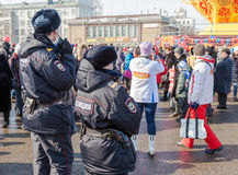 Police patrol at the Shrovetide celebration. Royalty Free Stock Photo