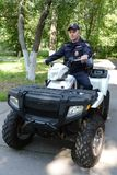 Police patrol the streets  in the suburban town of Khimki on the quadrocycle. Royalty Free Stock Images
