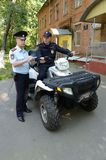 Police patrol the streets  in the suburban town of Khimki on the quadrocycle. Stock Photos