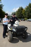 Police patrol the streets  in the suburban town of Khimki on the quadrocycle. Stock Photography
