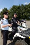 Police patrol the streets  in the suburban town of Khimki on the quadrocycle Royalty Free Stock Images