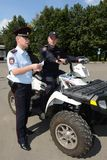 Police patrol the streets  in the suburban town of Khimki on the quadrocycle Stock Image