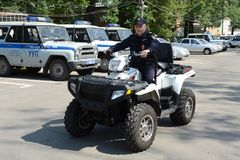 Police patrol the streets  in the suburban town of Khimki on the quadrocycle Stock Images