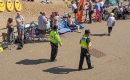 Police patrolling Eastbourne seafront, England Stock Photography