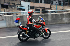 Police patrols on motorbike Stock Image