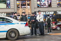 Police pays attention at times square by night Royalty Free Stock Image