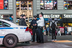 Police pays attention at times square by night Stock Photos