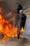 Police and petrol bombs Royalty Free Stock Images