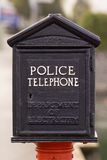 Police Phone. An antique police telephone on the street Stock Photography