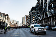 Police Pick-up Truck in front of the Protesters controlling the Royalty Free Stock Images