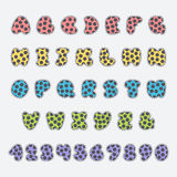 Police pointillée colorée et nombres de vecteur Images stock