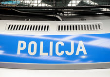Police in poland. Police inscription on blue background on police van in Poland Royalty Free Stock Image