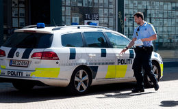 Police. Man with a car in Odense Stock Photo