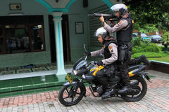 Police. Practice shooting from a motorcycle to anticipate crime in the countryside in Karanganyar, Central Java, Indonesia royalty free stock photography