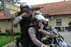 Police. Practice shooting from a motorcycle to anticipate crime in the countryside in Karanganyar, Central Java, Indonesia royalty free stock photos