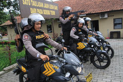 Police. Practice shooting from a motorcycle to anticipate crime in the countryside in Karanganyar, Central Java, Indonesia royalty free stock images