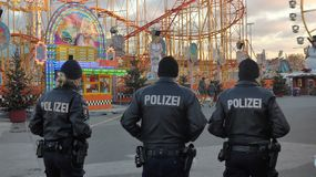Police presence  at  a  folk festival at Christmas time. Police presence  at  a  folk festival `Hamburger Dom` at Christmas time Royalty Free Stock Image