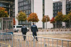 Berlin, October 2, 2017: Two policemen are patrolling. Police presence on the streets of the city. Protection of public. Police presence on the streets of the Royalty Free Stock Photos