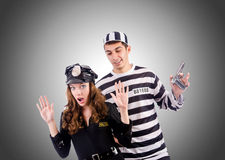 Police and prison inmate against the gradient Royalty Free Stock Photos