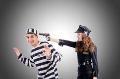 Police and prison inmate on the white Royalty Free Stock Image