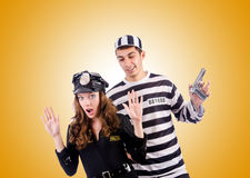 Police and prison inmate on the white Royalty Free Stock Images