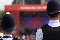 Police protect crowds at Canada Celebrations in London 2017. Canada Day celebrations 2017 in Trafalgar Square in London. Crowds of happy people wearing Canadian royalty free stock images