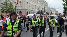 Police protect gay event stock video footage