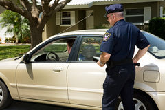 Police - Pulled Over. Policeman pulling over a motorist on the street Stock Photo