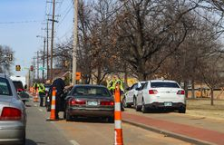 Police pulling over black cars looking for someone at 21st and Peoria Ave Tulsa Oklahoma USA 02 14 2018. Police pulling over black cars and looking for someone Royalty Free Stock Photography