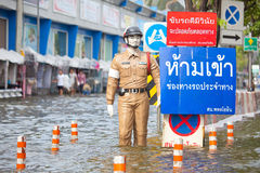 Police puppet standing on flood Stock Image